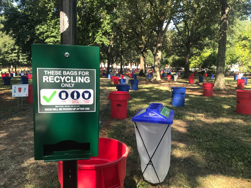 Photo of a green recycling dispenser in the Grove.